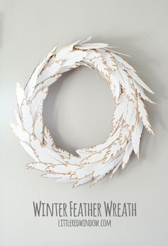 Make your own Wintry Paper Feather Wreath, it's fluffly, sparkly, gorgeous and best of all, easy! via littleredwindow.com