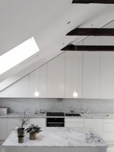 Marble kitchen in attic with exposed beams