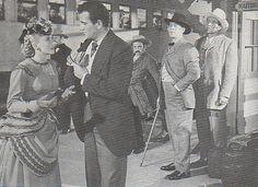 "Vera Ralston, John Wayne, Ward Bond, and Mike Mazurki in the 1945 western ""Dakota."""