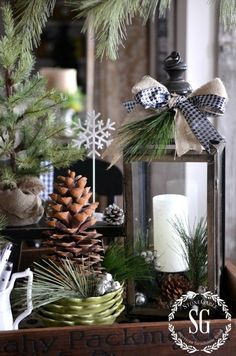 lantern with ribbons, candle, pine, large cone, burlap sack tree, white edged cones, wooden tray, black and white hounds tooth ribbon.