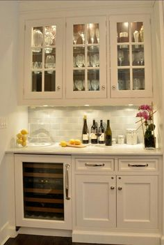 Butler's pantry with granite and wine fridge