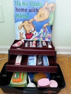 BOOK BABY SHOWER CENTERPIECE - tackle box filled with baby medicine needs.  includes tylenol, advil, gas drops, bandaids, sanitizer wipes, saline q-tips, boogie wipes, nasal aspirator, teething rings, cold packs, petroleum jelly, chest rub, thermometer.  BOOK - Llama Llama Home with Mama