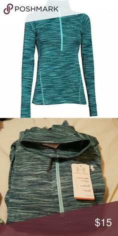 Under Armour compression zip up Kind of a tealish/aqua color. Super cute and soft. Under Armour Tops Sweatshirts & Hoodies