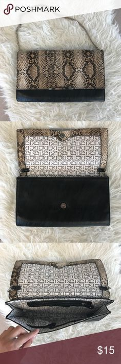 Danielle Nicole large faux snake skin clutch Danielle Nicole large faux snake skin clutch with magnetic snap button closure and chain handle detail. Some discoloration on chain. Danielle Nicole Bags