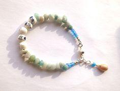 A personal favorite from my Etsy shop https://www.etsy.com/listing/265324718/beach-bracelet-pale-aqua-blue-with