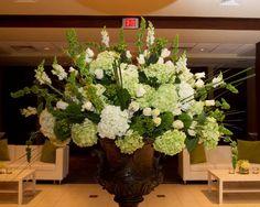 Arrangement of greens and ivories. Breathtaking design. Concept Jackie Frontiero, design Dana Bennett Dana's Floral Design, LLC. Prattville, AL
