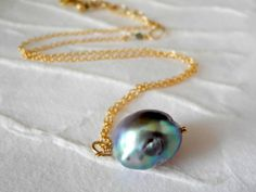 Gorgeous dark pearl necklace on gold fill chain.