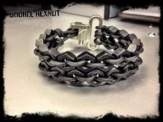 This bracelet is made with 2 rows of hex nuts and tied with 4 strand paracord which has a 275 lb test strength. It attaches to a stainless steel spring loaded closure to give it a truly unique look. When you place and order please include your wrist size and color of hexnut you would like. The colors are listed in the picture provided, we currently have stainless steel, black, and green.