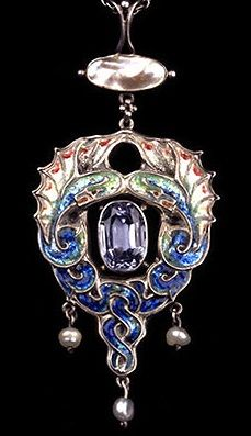 JAMES CROMAR WATT (1862-1940) A silver pendant of entwined, enamelled serpents surrounding a sapphire, the pendant with pearl drops. Scottish. Circa 1900. Unmarked.