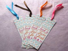 cute and colorful bookmark wedding favor for a book themed wedding. the person at the table who finds it gets to keep the book!