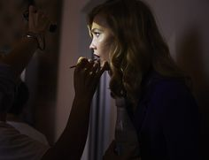 Karlie Kloss gets a quick touchup in between scenes on the #DVFSecretAgent film set. See the professional tips for achieving her seductive look on World of DVF: http://on.dvf.com/1MD3Tn1