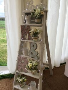 Our vintage ladder (available to hire) with beautiful wild flowers and candles; a perfect accessory for the welcoming area of the marquee. www.effervescenceevents.com