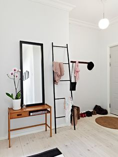 Metal ladder frame instead of chair for hanging clothes to wear again