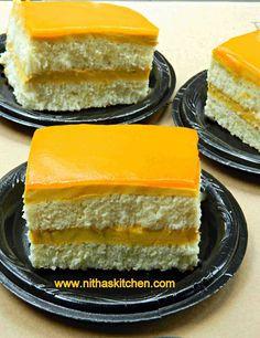 Double Layered Vanilla Cake with egg less Mango mousse filling and Mango glaze