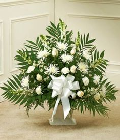 The all-white sympathy bouquet is a beautiful gift to send to show your care and concern. Description from search.fromyouflowers.com. I searched for this on bing.com/images