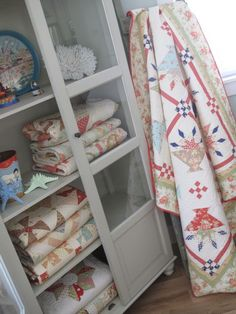 A cupboard full of our favorite quilts made with Fig Tree fabrics - lovely