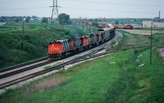 Count them: five MLW M420W #2561 – 2570 – 2572 – 2565 – 2525 westbound near mile 304 Kingston Subdivision - the approach to Whitby. Note the...