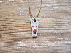 Ceramic Pendant. Mask #2. Ceramic Necklace. One of a kind hand molded charm. Hand made pottery mask pendant.