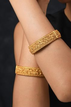 Gold Plated South Indian Temple Work emboss Bangles With Floral Motifs. Closure - ScrewIntricacies of South Indian templ Gold Bangles Design, Gold Earrings Designs, Gold Jewellery Design, Indian Gold Jewellery, Gold Jewelry, Indian Bangles, Women Jewelry, Gold Mangalsutra, Bangle Set