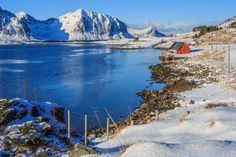 Reine, Norway - Visit the scarcely-populated fishing village of Reine to take a scenic boat trip along Aqua Lofoten coast.