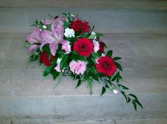 Single ended sympathy tribute with a mix of red and pink blooms. Grave Flowers, Funeral Flowers, Hope Floats, Funeral Tributes, Red And Pink, Floral Wreath, Poster Prints, Bloom, Floral Garland