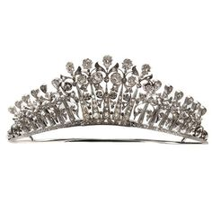 From 1890s, a variation on the diamond fringe tiara with foliate motifs and topped with pear-shaped diamonds