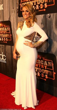 'I'm opening the show!'Pregnant Carrie Underwood sported a golden glow before opening the...