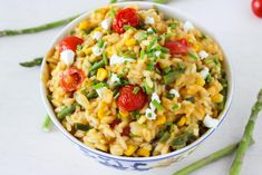 A hearty, creamy gluten-free risotto with summertime vegetables and tangy goat cheese. A stunning vegetarian main dish or a flavorful side dish.