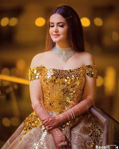 Gold embellished bodice, which opened into a full lace voluminous ball gown skirt with gold appliques. Indian Gowns Dresses, Bridal Dresses, Stylish Dresses, Fashion Dresses, Engagement Gowns, Reception Gown, Indian Bridal Outfits, Bridal Lehenga, Bridal Mehndi