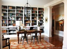I love this room. Wonder if hubby will let me convert our unused dining room? Love the book case!