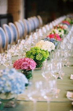 Very pretty reception idea to have one vase that has all the same flower, but all different flowers in general. Might save money...