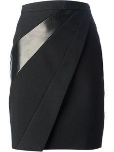 Jupe crayon à empiècement en cuir en laine et soie noire Saint Laurent avec taille haute, découpe en diagonale et fermeture zippée dissimulée au dos.