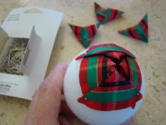 Use Ribbon to Make Pretty Pinecone Ornaments - Matt and Shari Xmas Baubles, Fabric Christmas Ornaments, Pinecone Ornaments, Homemade Christmas Decorations, Pine Cone Decorations, Quilted Ornaments, Homemade Ornaments, Christmas Crafts For Gifts, Christmas Traditions