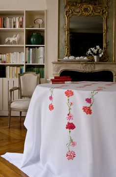 who can resist these hand embroidered flowers spilling off an exquisite linen tablecloth