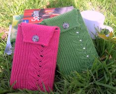 """Cozy Fire is a seamless, protective Cozy to pamper your Kindle. It is knit like a toe-up sock on a magic loop, so you can try it on as you go. It has a simple flame lace pattern and a one-button closure. It is a quick knit and a perfect companion to your Kindle Fire, Kindle 2, Kindle 3 and now Kindle Fire HD and Kindle Fire HD 8.9""""!"""
