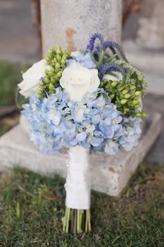 flowers for weddings in periwinkle color | Lee's bridal bouquet consisted of blue hydrangea, white roses, purple ...