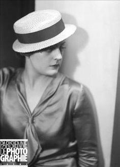 straw boater hat worn with silk satin tie neckline shirt, 1934