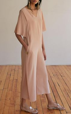 The designer: Founded by Ali Hewson, New York-based Edun is a pioneer in sustainable fashion, committed to African manufacturing and production.    This season it's about: Modern luxury—think midi fringe skirts, not-so-classic trenches and pieces that reflect local craft.    The piece to buy: Make room in your wardrobe for the cool cropped pants.