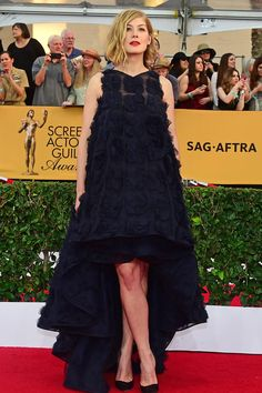The Boldest Red Carpet Looks From The SAG Awards #refinery29  http://www.refinery29.com/2015/01/81264/sag-awards-2015-red-carpet-pictures#slide-21  Rosamund Pike has made herself known as a fashion daredevil, and she really bet high with this high-low, tent-style Dior dress covered in navy rosettes. The payoff was huge — the refreshingly weird silhouette was also stunning.
