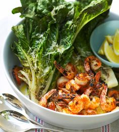 Grilled Shrimp and Romaine Halves of romaine lettuce get a smoky flavor when grilled. Served with quick-cooking seafood kabobs for an easy dinner.