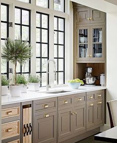 Cabinets are a little dark, but the hardware and windows are perfect.