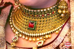 Indian Wedding jewelry - Gold Choker Necklace with Ruby Pendant in an Emerald Setting and Hanging Pearls | WedMeGood #indianbride #indianjewelry #choker #indianwedding #wedmegood #necklace