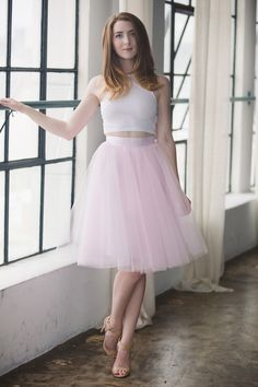 "This skirt features 4 layers of tulle, fully lined with a hidden back zipper. All length is approximately 25"". Sizing Size 24W - XS - Waist 24"" (12"" across laying flat), equivalent to US 00 Size 25W -"