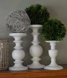 White candle holders on mantel
