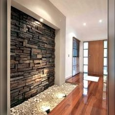 CraftStone is often used on exterior walls as stone wall cladding, but is now increasingly being used in interior design to create feature walls and focal points inside homes and businesses. Indoor Stone Wall, Stone Feature Wall, Water Feature, Stone Wall Design, Stone Panels, Unique House Design, House Entrance, Entrance Ideas, Entryway Ideas
