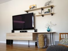 Entertainment Center DIY from {Sewing Barefoot} http://sewingbarefoot.blogspot.com/2013/02/entertainment-center.html