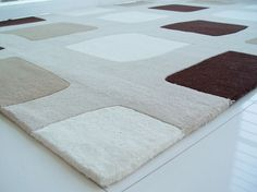 This neutral rug will bring out the white floors and add a touch of personality to the room
