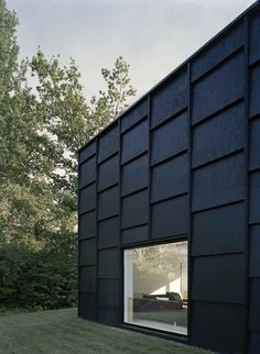 12 Modern House with Black Exteriors: The black-glazed shingle panel façade lends an earthy feel to this contemporary summer house in Sweden by Tham & Videgård Arkitekter. This photo by Ake E'son Lindman shows just one side. The next image illuminates the interesting angles of the deck side.