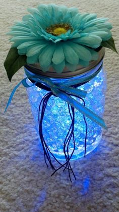 Mason jar, aqua beads, submersible LED light, flower, ribbon and twine.    Kristina - we could use any color beads and white glow sticks.