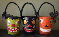 Plaster dipped peat planters are decorated with paint for Halloween. Great idea!